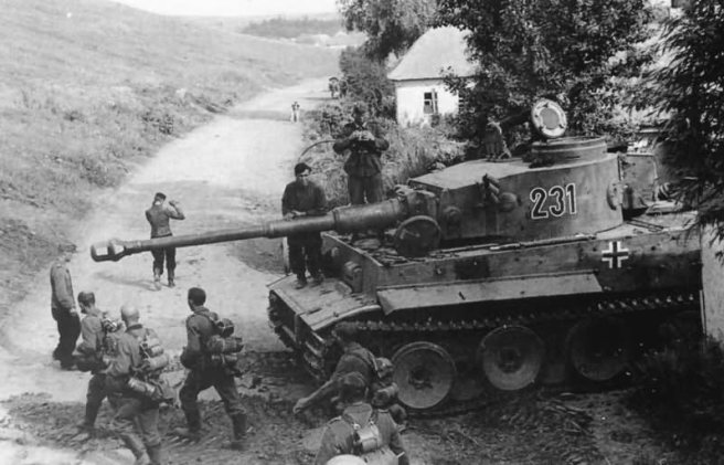This is Tiger 231. I don't know the unit it is a part of, but I think it's probably on the Eastern front during 1942 or early 1943 (It appears an Ausf. H or H1, notice the commander's cupola).